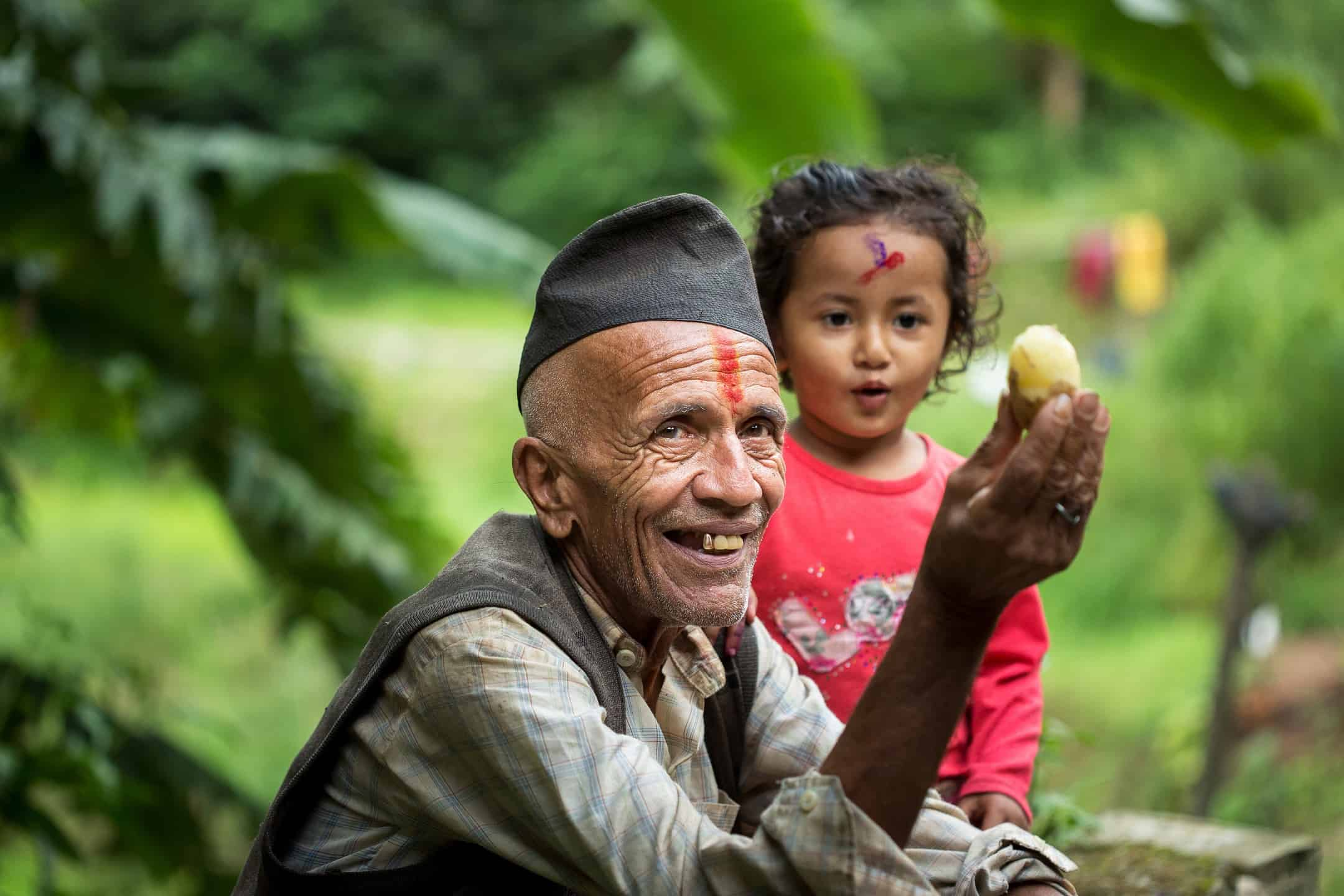 Photo of grandfather and child in Nepal